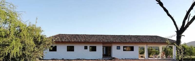 Parcela con Casa Nueva en Zapallar
