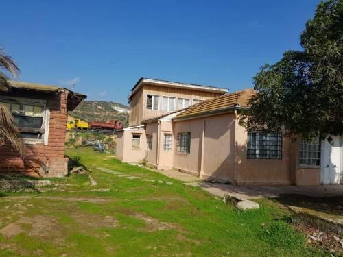 (2514) Vendo terreno con casa en Limache